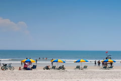 Beach umbrellas line Daytona Beach Stock Footage