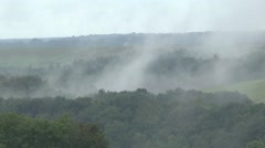 Mist rising from trees near Sivry, north east France. Stock Footage