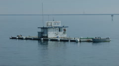 FLOATING HARBOR BAIT SHOP SITS QUIETLY INSIDE THE BREAKWALL Stock Footage