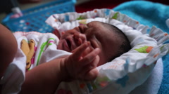 Close up of crying newborn baby that need a diaper change Stock Footage