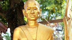 gilded statue of a Buddhist monk - stock footage
