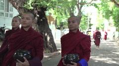 Amarapura, monks walking at Mahagandayon monastery Stock Footage