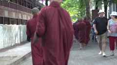 Amarapura, monks in line at Mahagandayon monastery Stock Footage