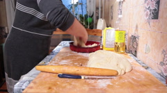 Caucasian woman placing some part of dough in silicon baking dish for pie cook - stock footage
