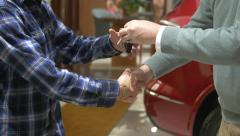 Customer receives keys to a new car. Stock Footage