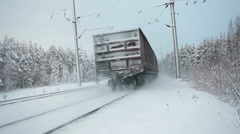 Rear view of vans of freight train in winter forest - stock footage