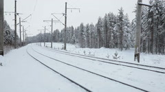 Empty snowy two ways railroad at winter season in evergreen forest, Karelia, Rus Stock Footage