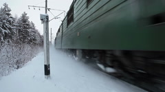 Close passing head engine of Russian freight train at winter railroad, Russia - stock footage