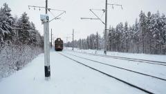 Real front view of freight train at winter railway in northern woods, Russia - stock footage