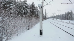 Empty railroad at winter season in woods of Karelia, north of Russia Stock Footage