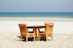 the table and chairs on beach of the luxury hotel, ajman, uae - stock photo
