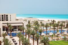 swimming pools and beach at the luxury hotel, saadiyat island, abu dhabi, uae - stock photo