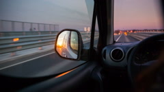 Reflecting sunset in car mirror Stock Footage