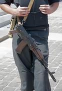 Ukrainian police officer with kalashnikov automatic rifle. Stock Photos