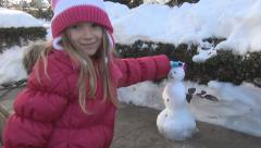 Child Playing with Snowman in Park, Little Girl in Snow, Winter Games in Forest Stock Footage