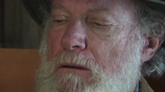 Old man, nodding off Stock Footage