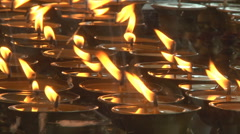 Burning oil lamps at temple in Ladakh, India (Jammu and Kashmir). - stock footage