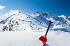 Avalanche shovel in the snow Stock Photos