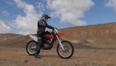Motocross driver start desert ride 4K 1 Stock Footage