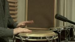 4K young man plays on percussion in a recording studio light slow motion Stock Footage