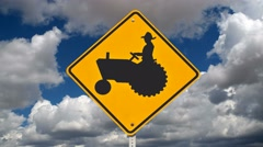 Farmer Crossing Safety Sign with Time Lapse Stock Footage