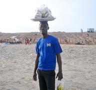 food seller on the beach - accra, ghana - stock photo