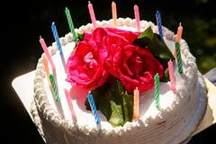 white creamy delicious cake with candles closeup - stock photo