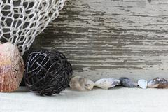 sea themed background with rustic wood and decorative fishing net - stock photo