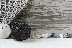 Sea themed background with rustic wood and decorative fishing net Stock Photos