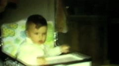 Infant in high chair Stock Footage