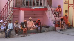 Indian sadhu, poor men sits along the Ganges river in Rishikesh, India Stock Footage