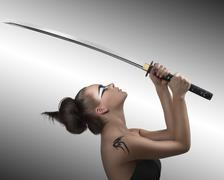 brunette in japan style with katana turned at left - stock photo