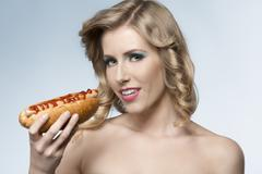 beauty girl with hot-dog - stock photo