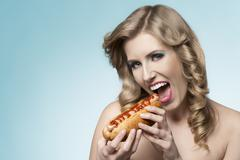 charming girl with hot-dog - stock photo