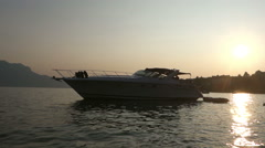 Yatch on Geneva Lake. Sunset and mountains. Arkistovideo