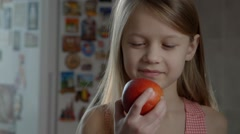 Long-haired girl eating an apple, HEALTHY FOOD Stock Footage