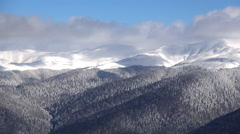 Time lapse. Aerial mountain landscape. Clouds moving in the wind. Winter season. - stock footage