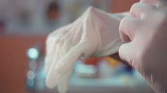 Hand and medical glove Stock Footage