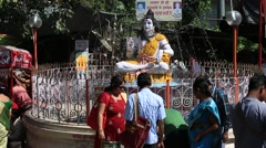 Statue Shiva, hindu idol with a fountain on the Ganges River in Rishikesh, India Stock Footage