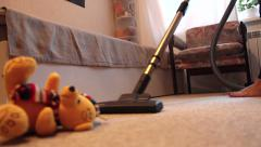 Vacuum cleaner cleans the floor in the nursery Stock Footage