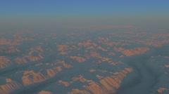 Sun on snow covered mountain in Canadian Yukon mountain Stock Footage