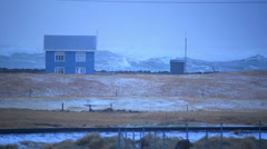 Small house in front of huge waves, heavy sea storm surge, Hafnir, Iceland - stock footage