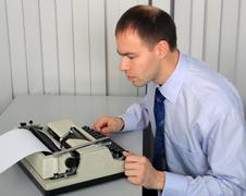 Businessman studies a rarity. Stock Photos