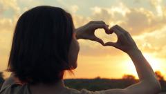Young Woman Making Love Heart Sign With Hands At Sunset, Valentines Day HD Stock Footage