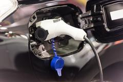 Electric Car Plug At Power Supply Stock Photos