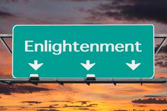 Freeway to enlightenment road sign with sunrise sky Stock Photos