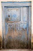 Entire old blue painted wooden door and lock Stock Photos