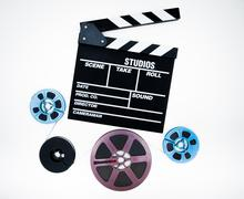 Clapper and 8mm different reels isolated on white background Stock Photos