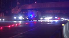 Patrol car reopens lanes of traffic Stock Footage