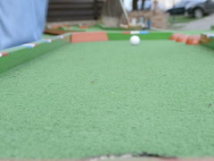 We hammer a ball into a hole. Related clips are in my portfolio in 1920x1080. Stock Footage